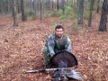 Lucky Hunter shows off his turkey